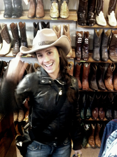Meghan trying on cowboy hats at Kowboyz